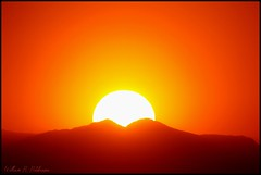 June 14, 2021 - The sun sets on a hot day. (Bill Hutchinson)