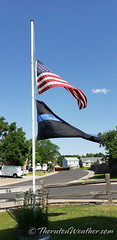 June 22, 2021 - Flags at half mast to honor Arvada PD Officer Gordon Beesley. (ThorntonWeather.com)