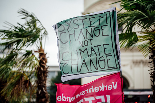 Close-up of a climate change protest banner. .System change, not climate change.