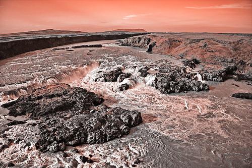 "Waterfall Urriðafoss in ""rust red"" coloring"