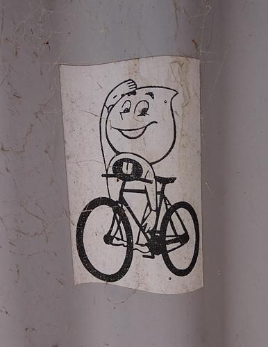 Strange Figure on Bicycle