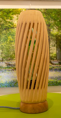 large Wood Turned lamp with a twist.