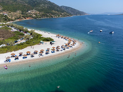 The two sides of Agios Dimitrios beach offer two different types of seabed. Aerial view of horseshoe beach