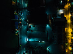 Bird View Night Drone Shot of Khanh Hoi Nha Rong Port with Transport Ships and Storage Halls in Ho Chi Minh City, Vietnam