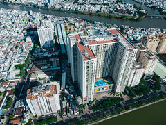 Aerial Drone Photo of The Gold View Apartment Building with Swimming Pool and Shopping Mall in District 4 of Ho Chi Minh City, Vietnam