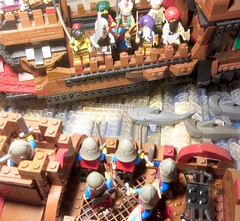 Classic Castle: Arabian Barbarian Pirates prepare to board a smaller ship of kingdom Medieval Knights and the Sharks Prepare for dinner (AFOL Vignette Sea LEGO Battle MOC scene) IMG_0001
