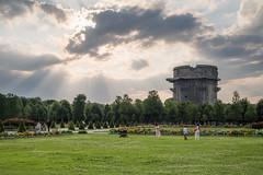 People in Augarten park, Vienna. Flak tower in the background