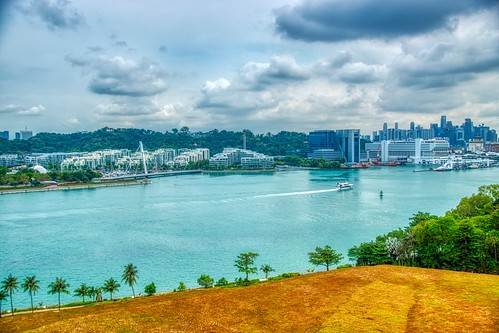 Harbour and Keppel Bay under a cloudy sky seen from Sentosa island in Singapore