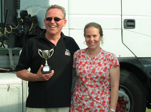A happy Ray Foley receives his Class E winner's trophy at Cadwell