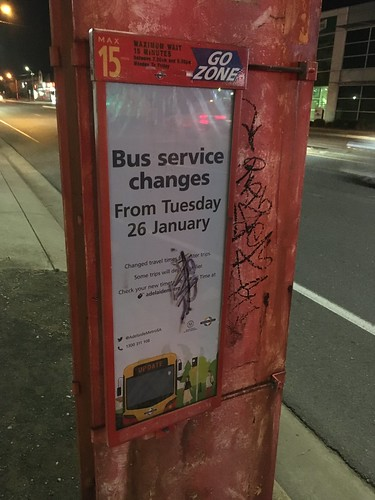 Sign at bus stop advertising bus service changes for 26 January 2021 in Adelaide, South Australia
