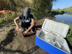 Filling a water sample jar