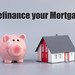 Piggybank and house with Refinance your Mortgage text on grey background
