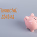 Piggybank with Financial Status text on grey background