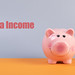 Piggybank with Extra Income text