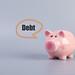 Piggybank with Debt text