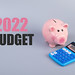 Piggybank with calculator and 2022 Budget text