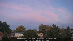 October 6, 2021 - Pastel colored clouds at sunrise. (ThorntonWeather.com)