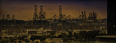Derricks and docks at dusk: Singapore