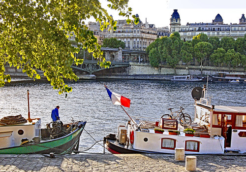Paris (France). Barges moored on the River Seine, close to the Tour Eiffel.