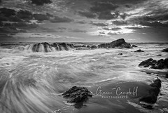 Spittal Rocks (gcfotographos) Tags: uk sea england sky blackandwhite bw seascape cold water clouds sunrise landscape dawn rocks europe britain ngc northumberland daybreak waterflow bythesea sunriselight watermotion beautyofwater scenicsnotjustlandscapes greatbritishlandscape landscapeseascapes